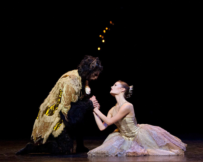 Delia Mathews as Belle and Iain Mackay as the Beast