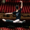 Male dancer leaps accross the stage